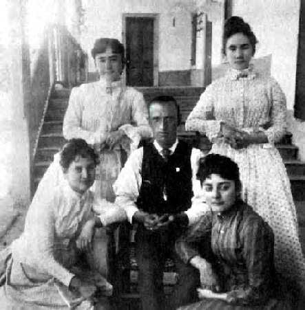 Charles Lummis poses at Rancho Camulos with women from the del Valle family