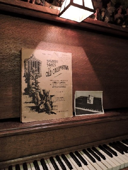 Spanish Songs of Old California, on piano with historic picture of a folio on a piano. Photo by Vykki Mende Gray